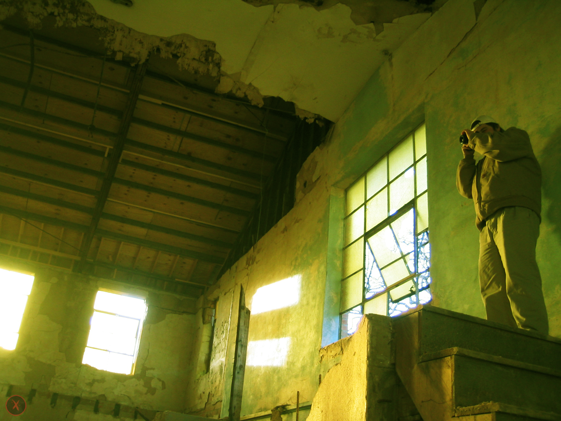 Ty capturing a photograph inside the abandoned factory